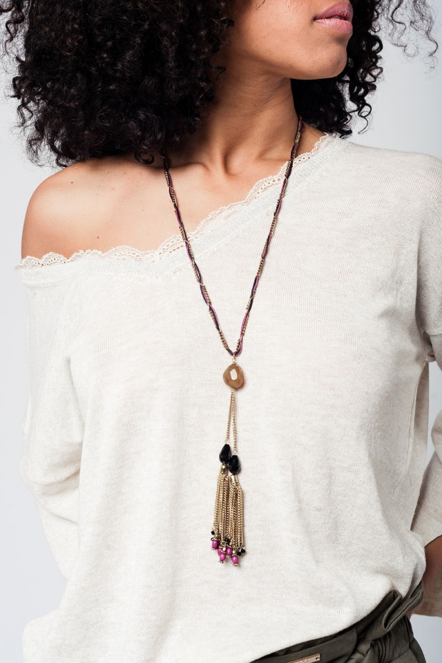 Gold necklace with tassels and purple details