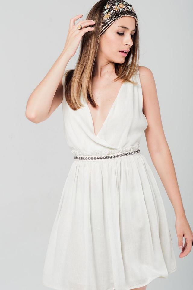 Gele mini jurk met studs op de taille