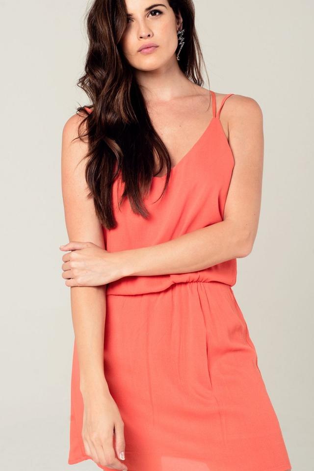Oranje mini jurk met gehaakt detail aan de achterkant