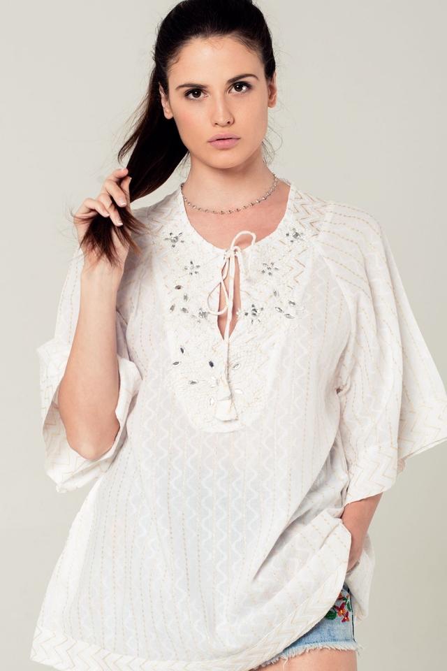 Witte mini jurk met geborduurde details