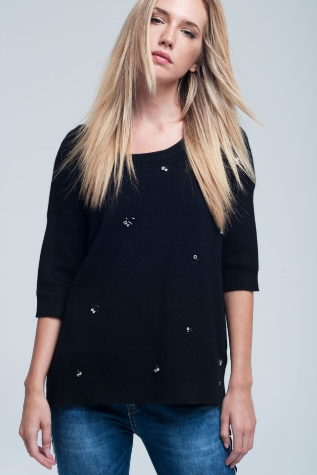 Asymetric black sweater detail pearls and open back