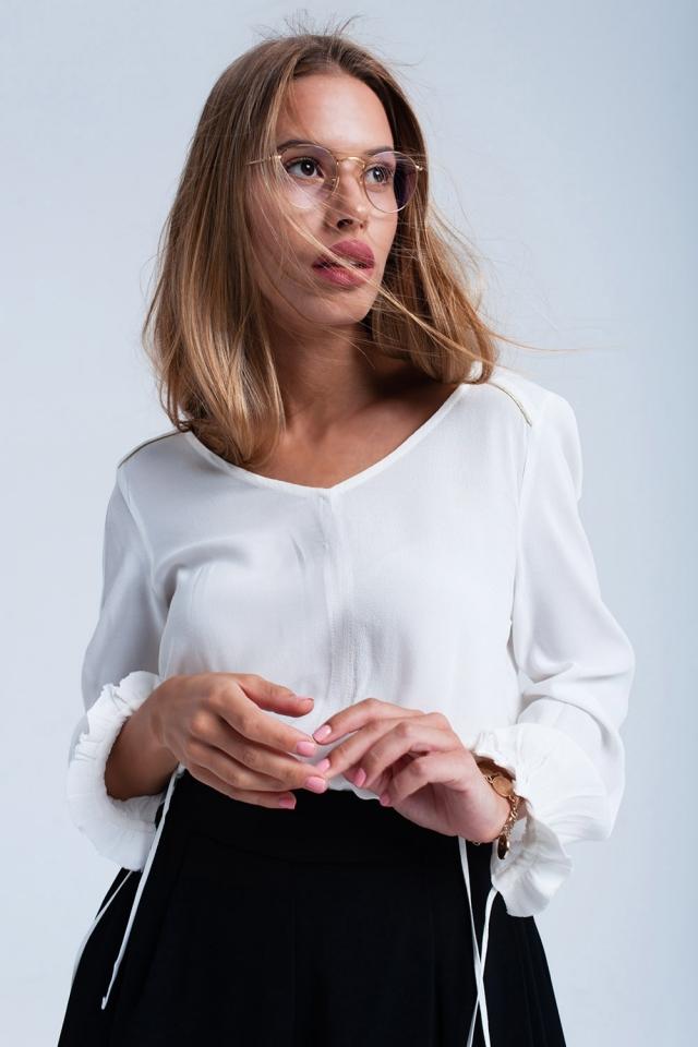 Witte vloeiende blouse