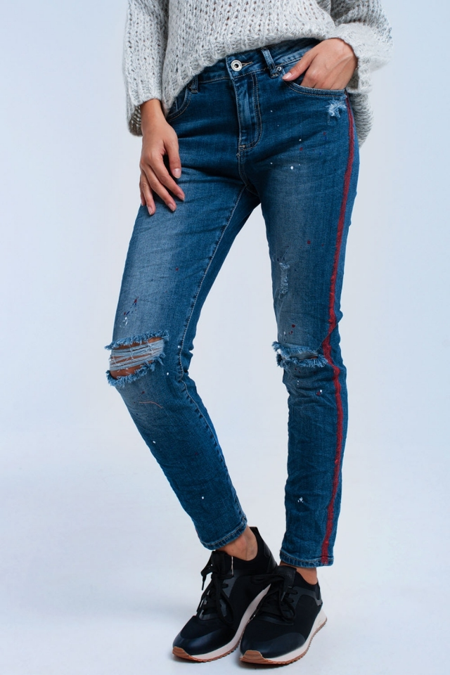 Painted skinny jeans with rips