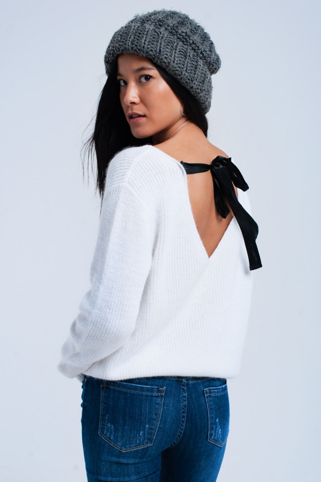 Cream sweater with black ribbons