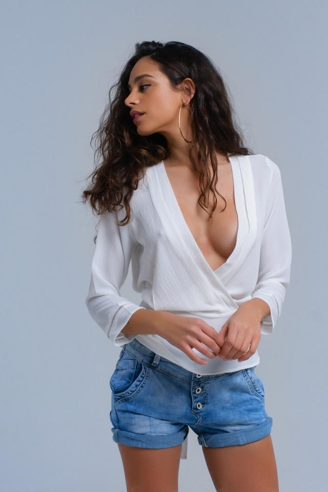 Wit gekruist shirt met strikken