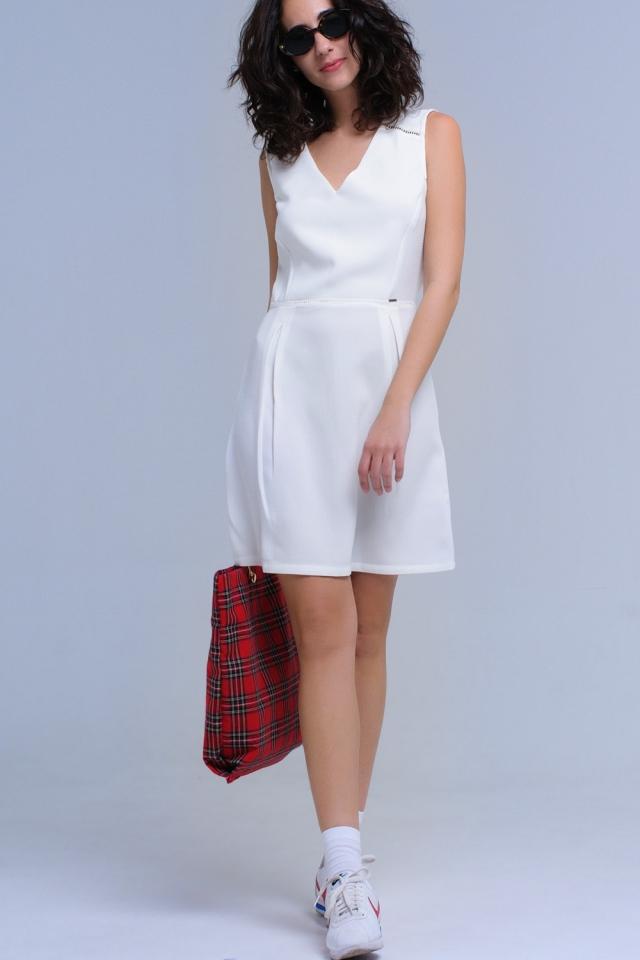 Witte jurk met crochet en strikken