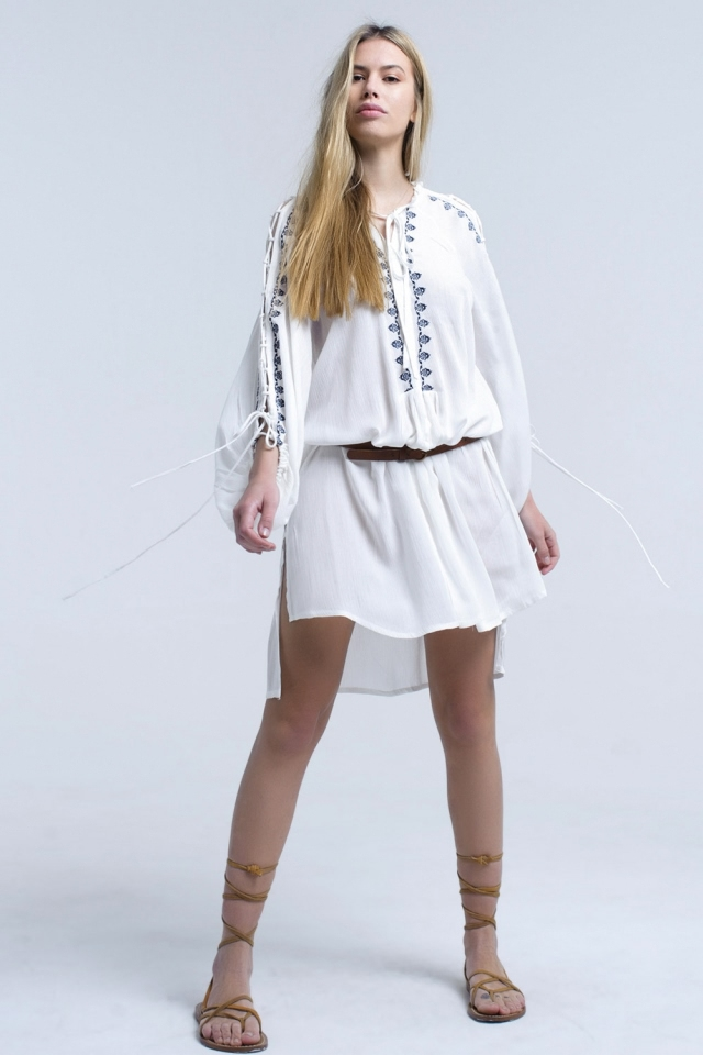 White embroidered dress with open sleeve detail