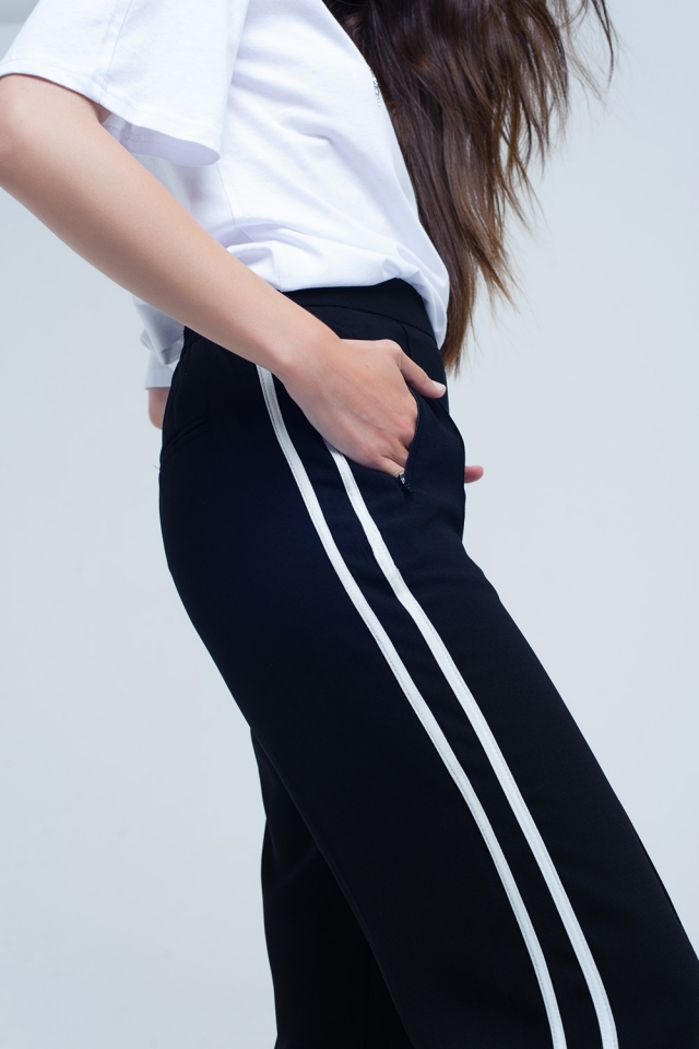 Black pants with white side stripes