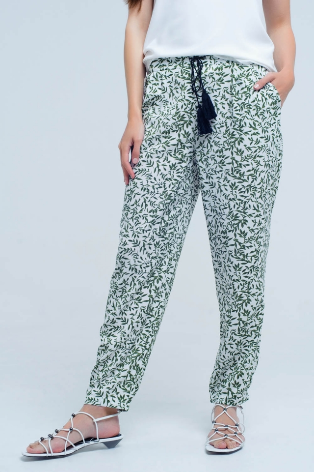Green pants with printed sheets and pockets