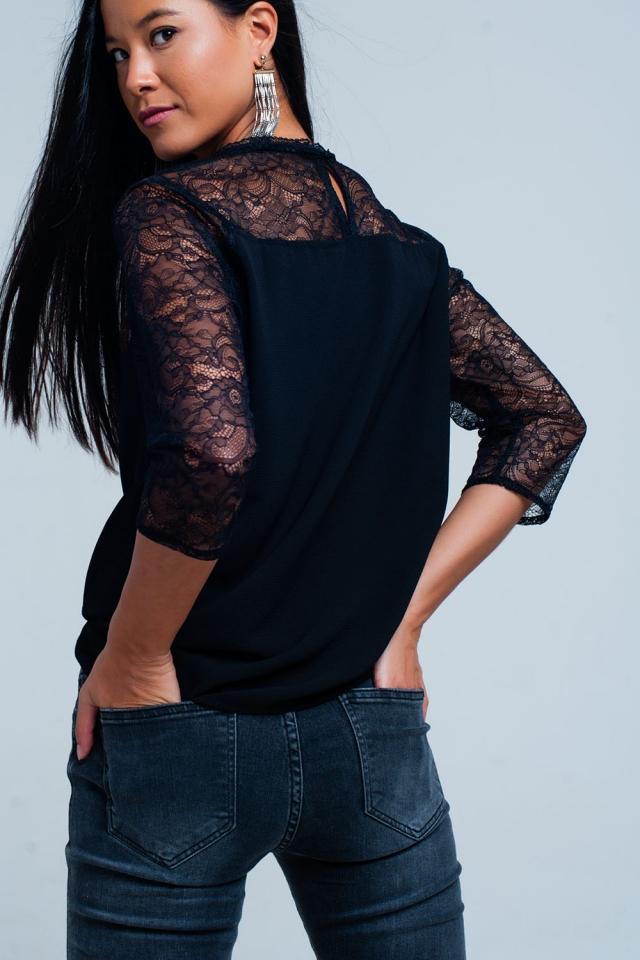 Blusa en negro con detalles de encaje