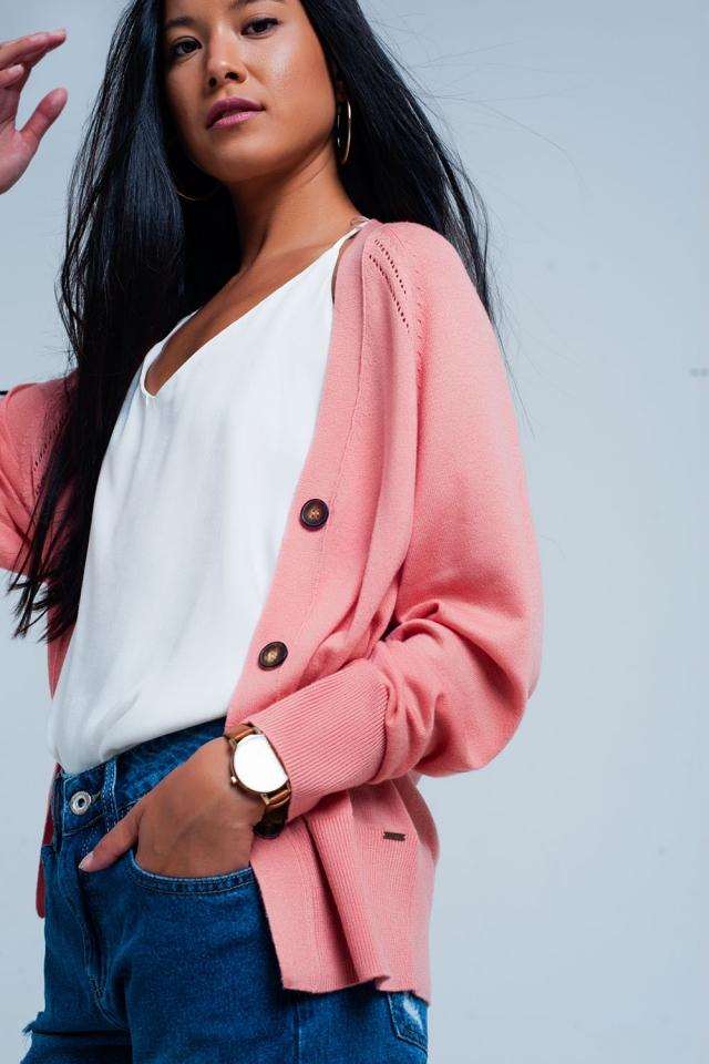 Roze vest met knoppen en edgy naad