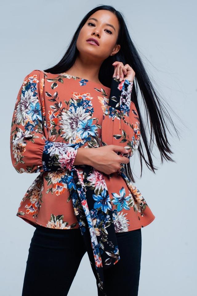 Roze bloemen print blouse gebonden aan de voorzijde