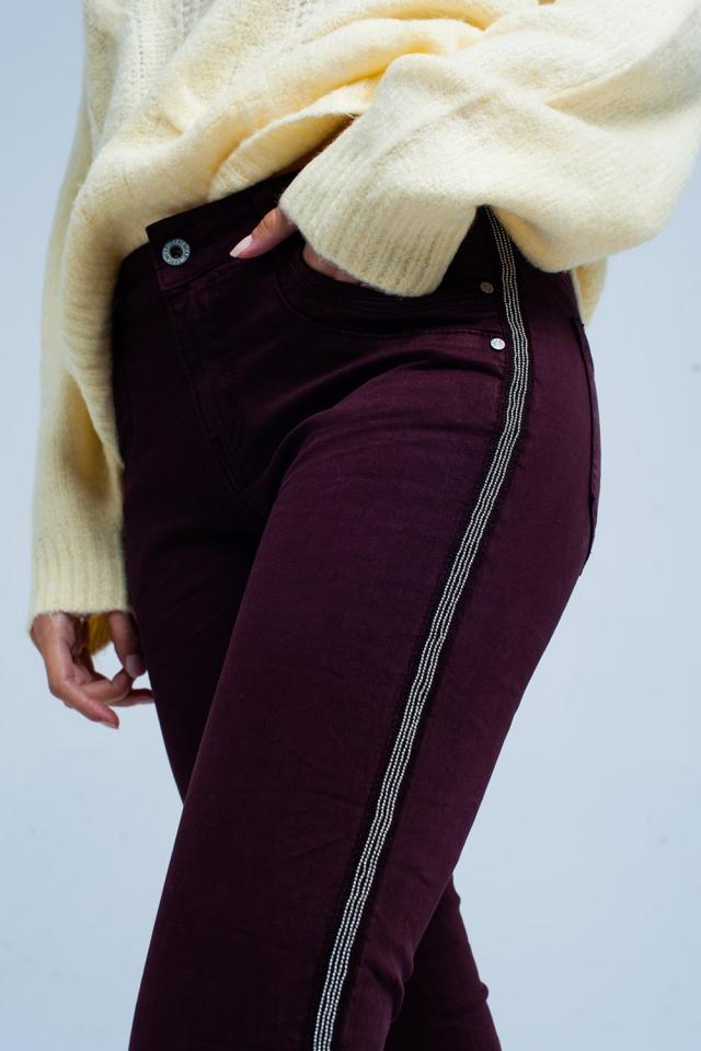 Bordeaux skinny jeans met metallic zijstreep
