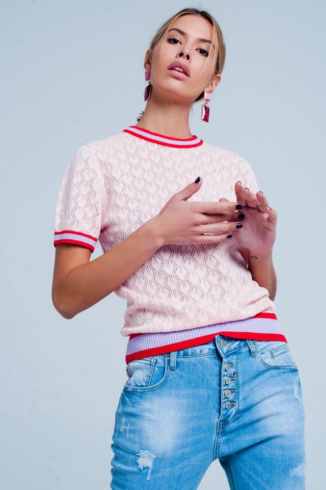 Open gebreide trui in rosa met geometrisch patroon