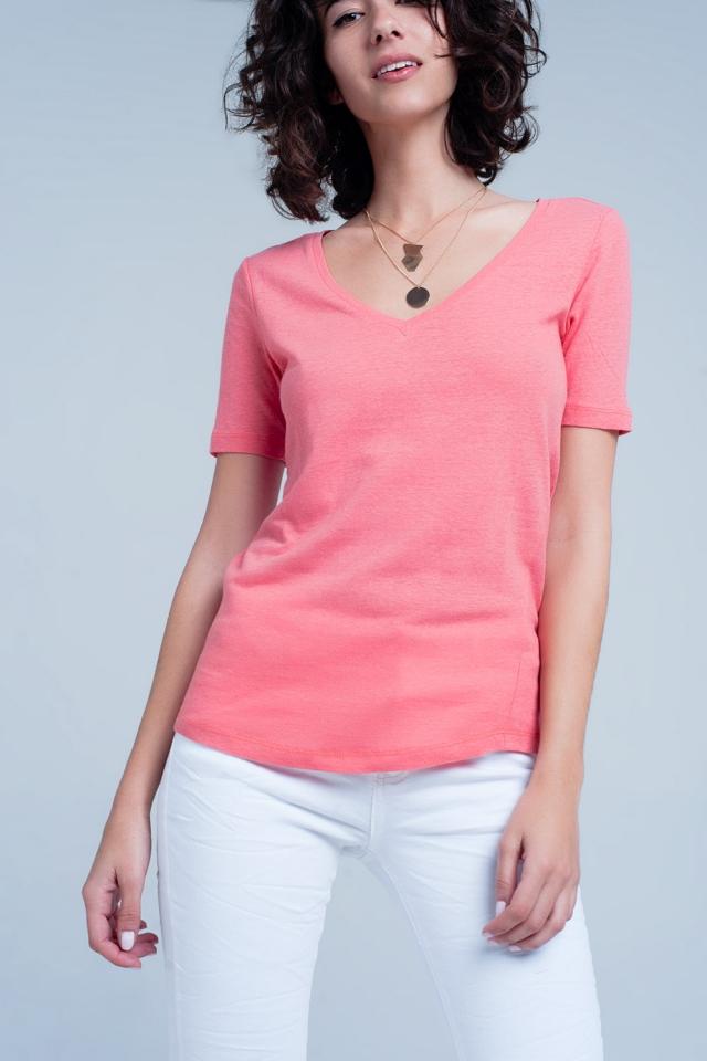 Koraal kleurig t-shirt met v-hals