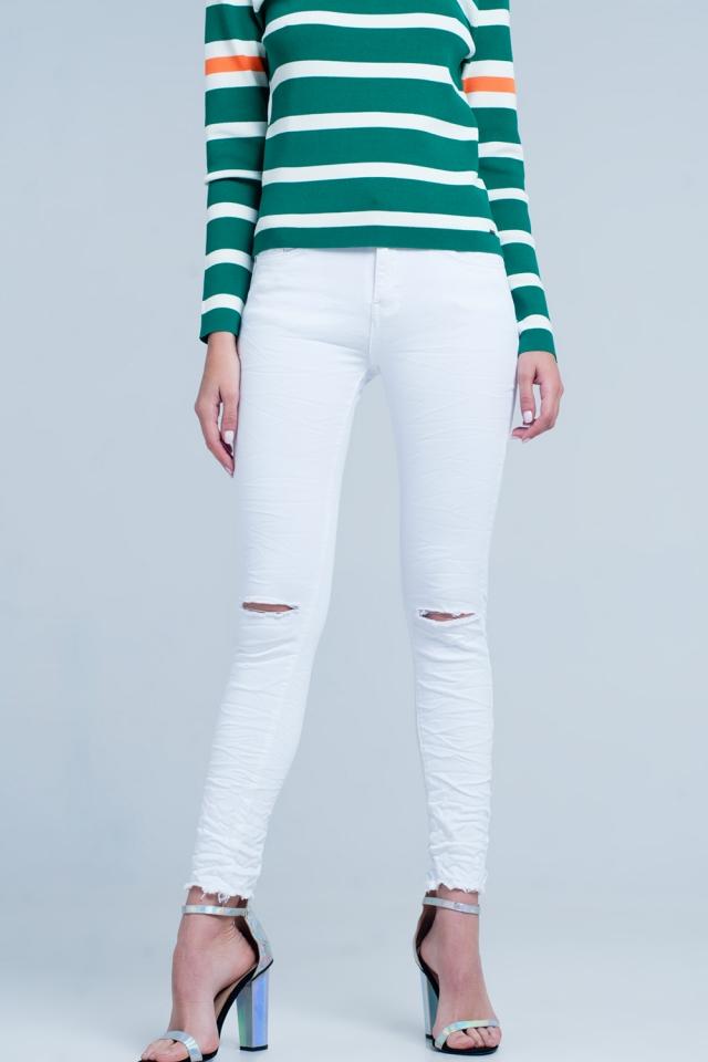 Witte skinny jeans met scheuren op de knieën