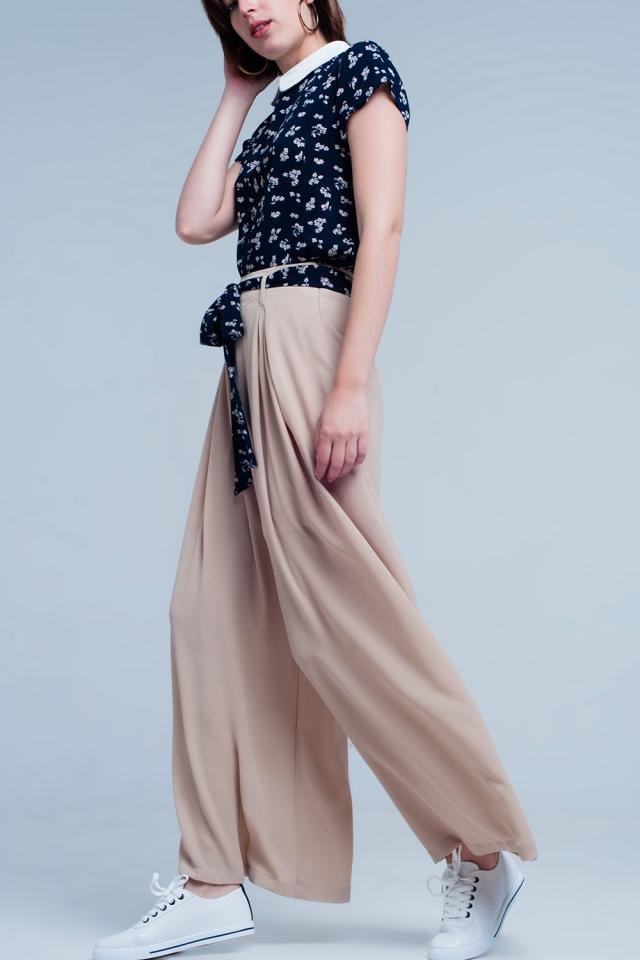 Beige broek met bloemenprint riem