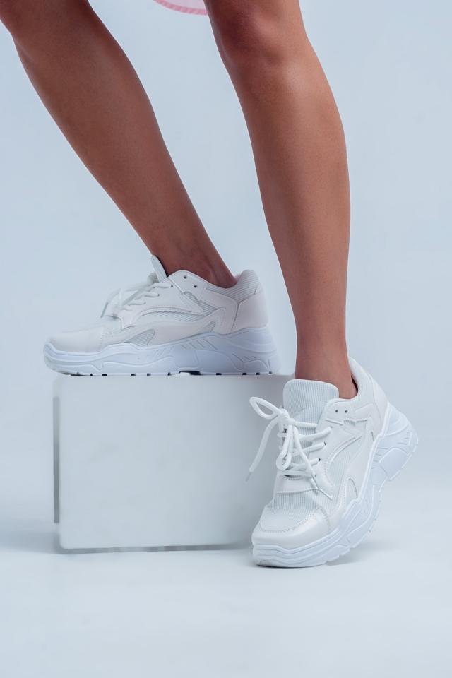 Witte sneakers met laag platform