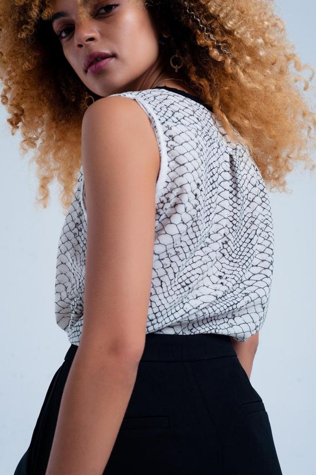 Mouwloze blouse met slangenprint