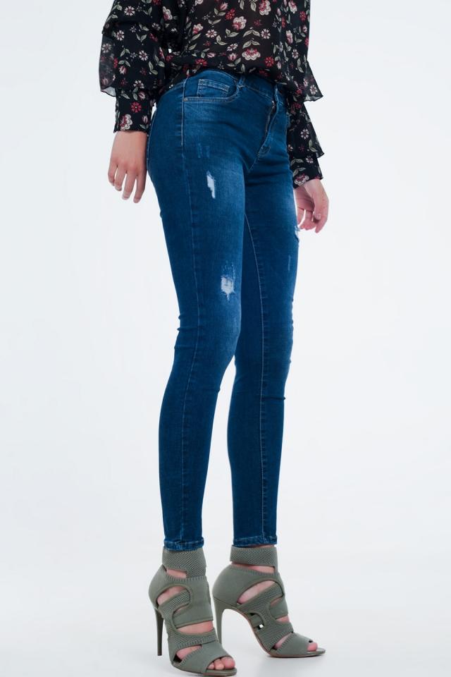 Skinny jeans met scheuren in blauw