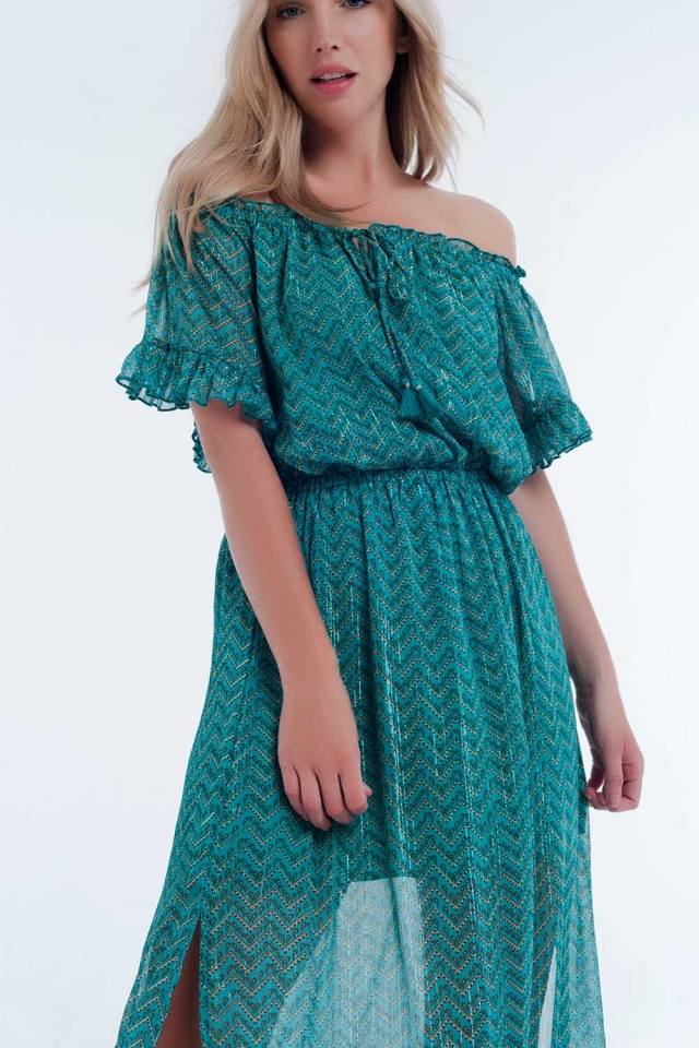 Lange jurk zonder  groene schouders met laagjes in een chevronprint