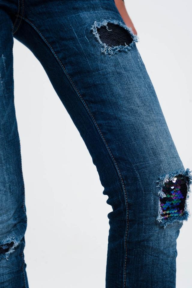 Jeans met pailletten en Rips