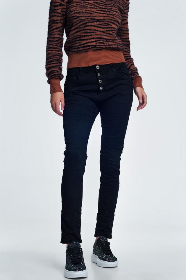 Zwarte jeans met knoopafsluiting