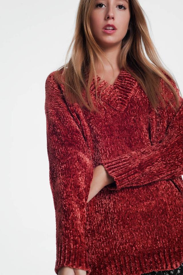 Lange trui in het oranje met lange mouwen en v-hals