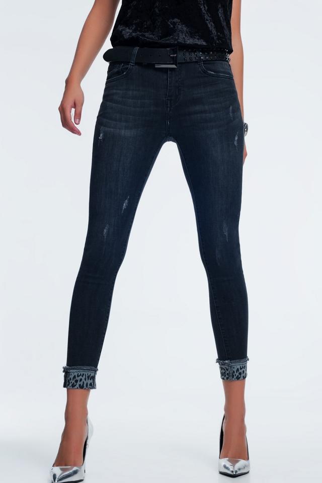 Donker grijze skinny jeans met tijgerprint detail bij de enkel
