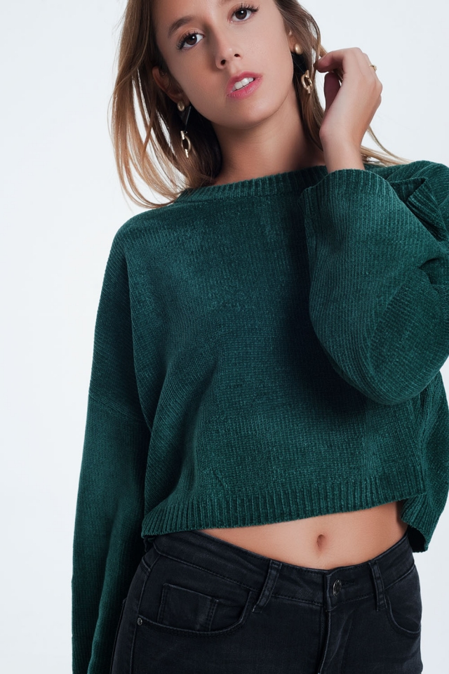 Groene trui met wijd uitlopende mouwen