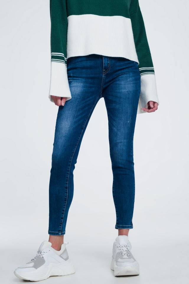 Skinny jeans met split aan de enkel