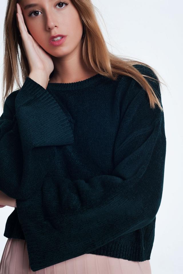 Zwarte trui met wijd uitlopende mouwen