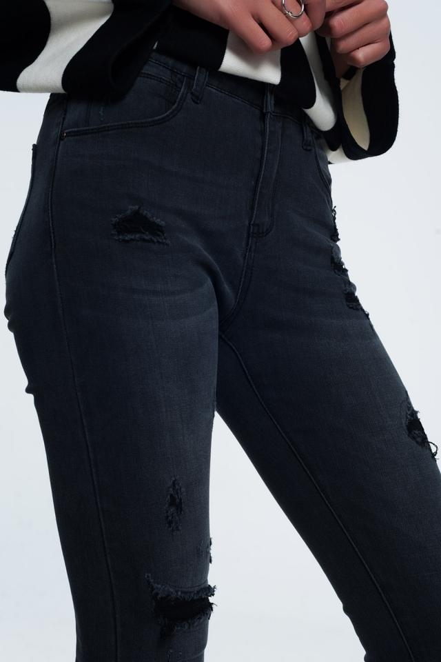 Gescheurde skinny jeans in zwart