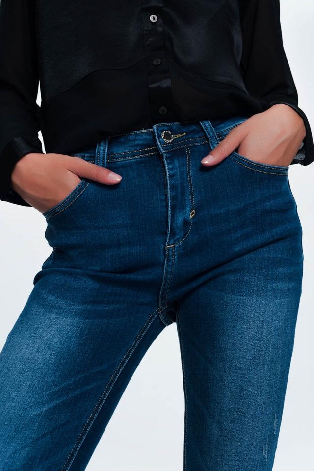 Blauwe skinny jeans in halve wassing