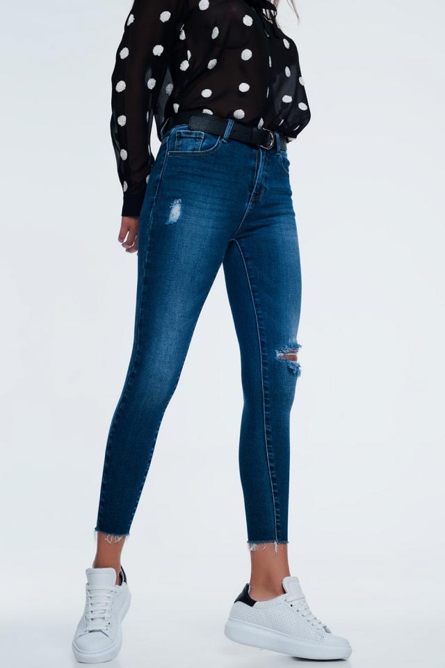 Blauwe gescheurde skinny jeans