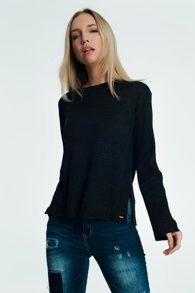Zwarte sweater met geribbeld en gebreid detail