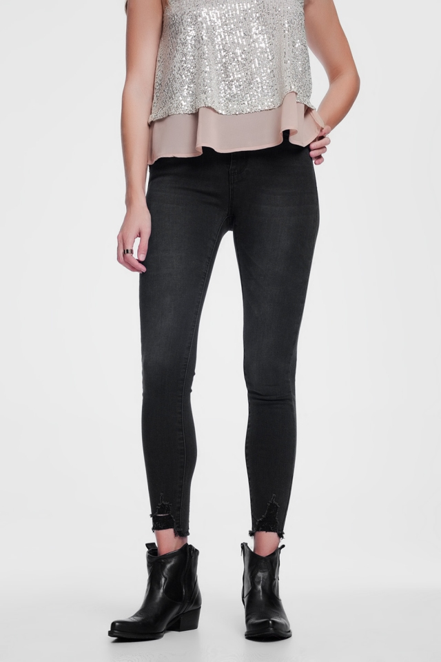 Distressed hem skinny black jeans