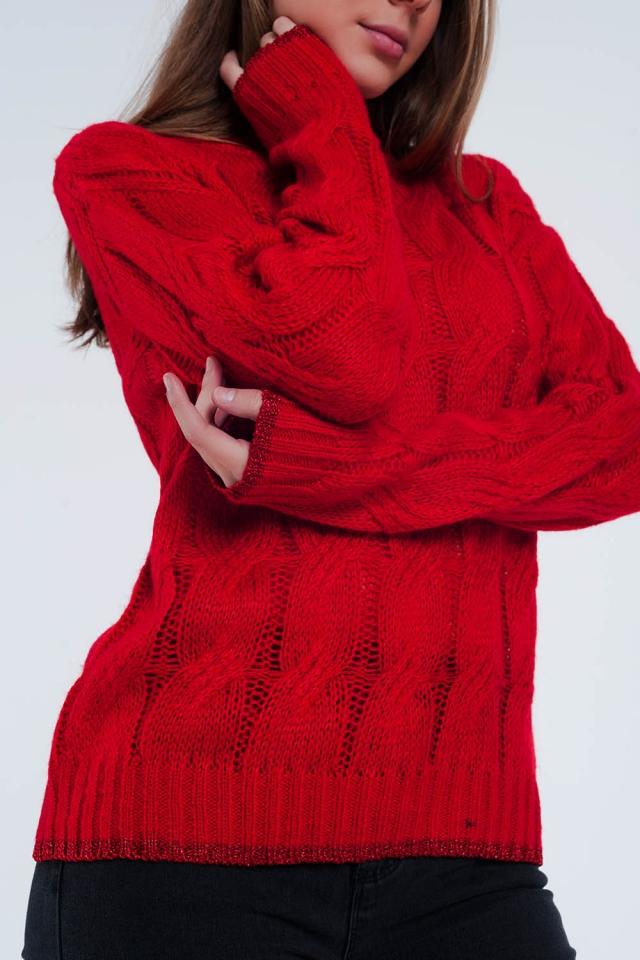Rode trui met kabel brei detail