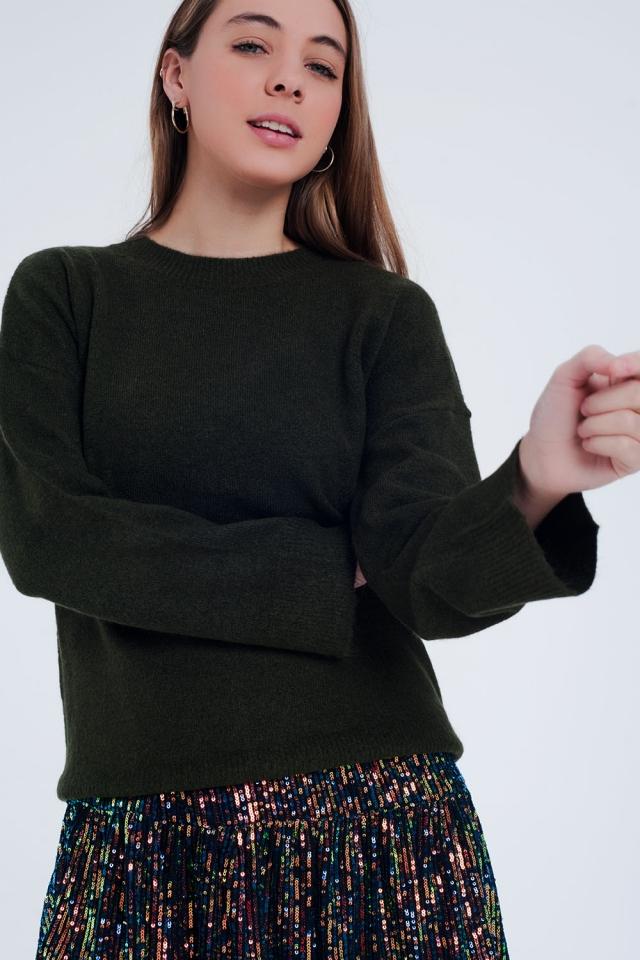 Groene trui met ronde hals en wijde mouwen