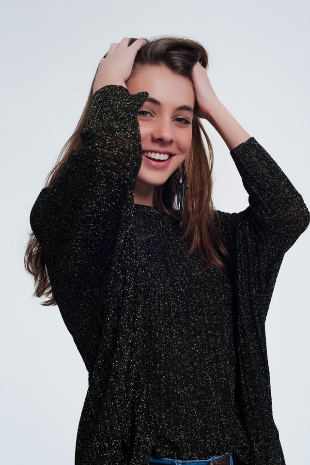 Zwarte trui met gouden glimmende details