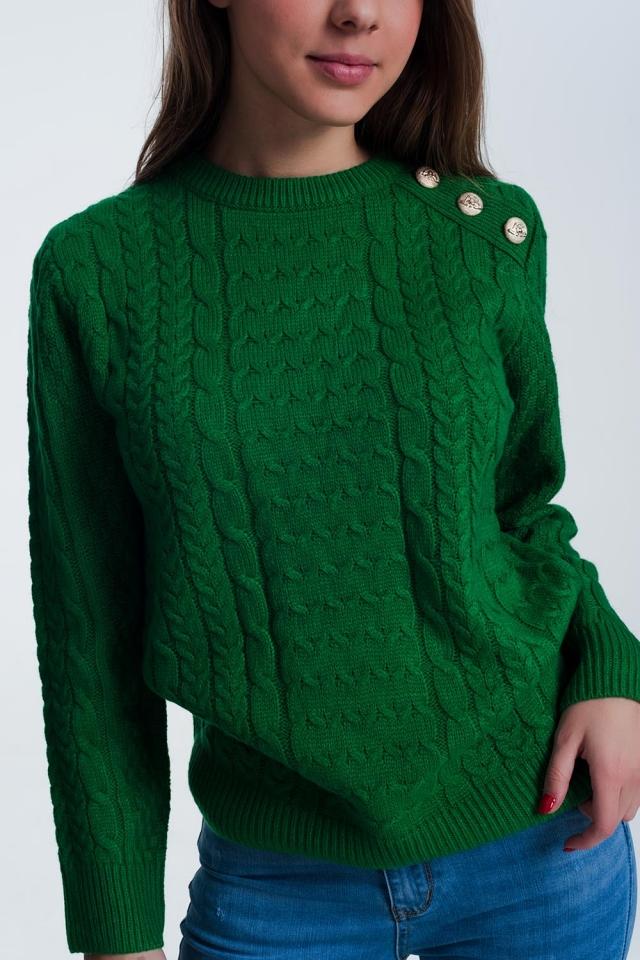 Trui in het groen met knopen detail op de schouder