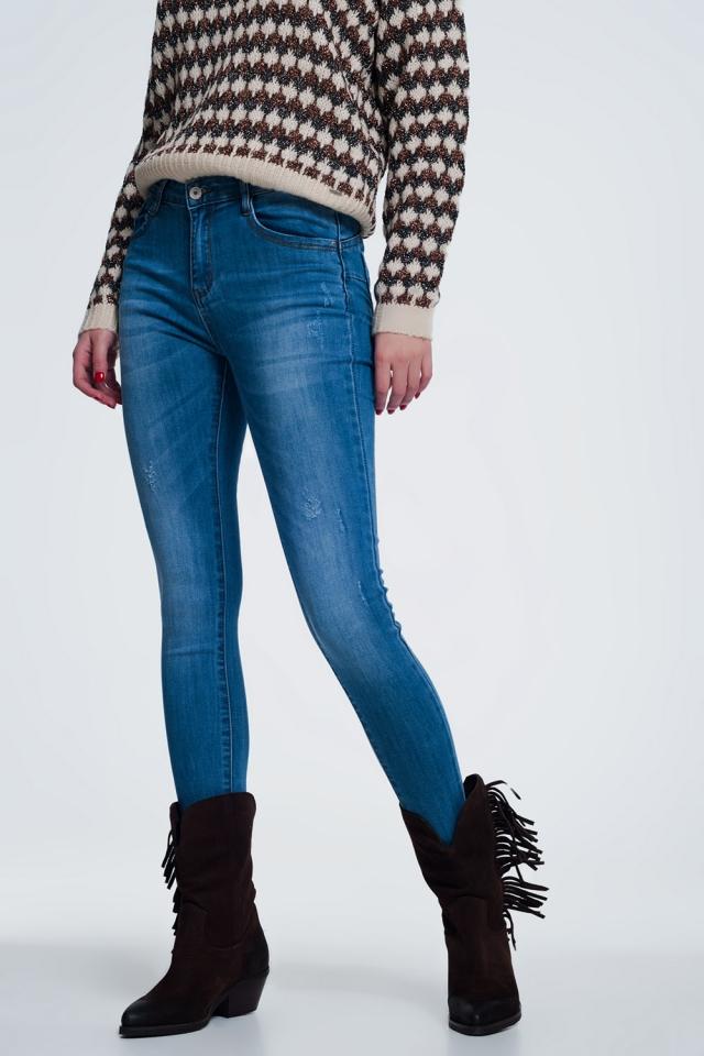 Lichte denim skinny jeans met wear detail