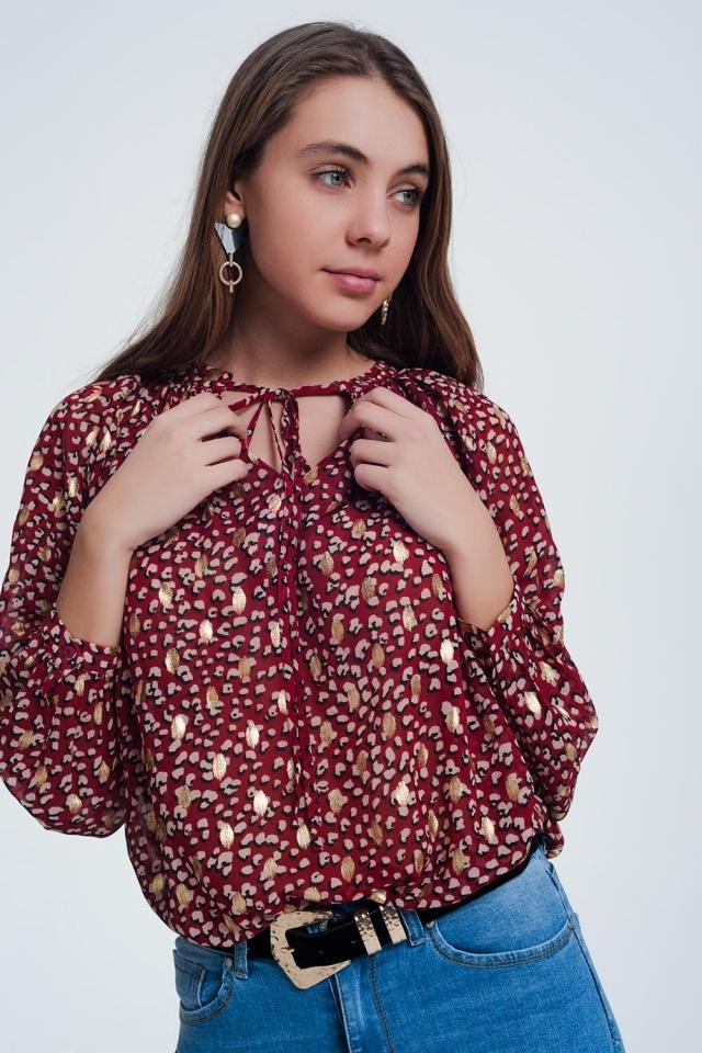 Rood shirt met lange mouwen en glimmende stippen