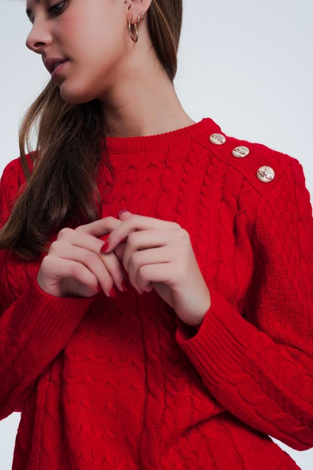 Trui in het rood met knopen detail op de schouder