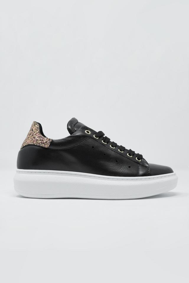 Sneakers met dikke zool in zwart en gouden glitter