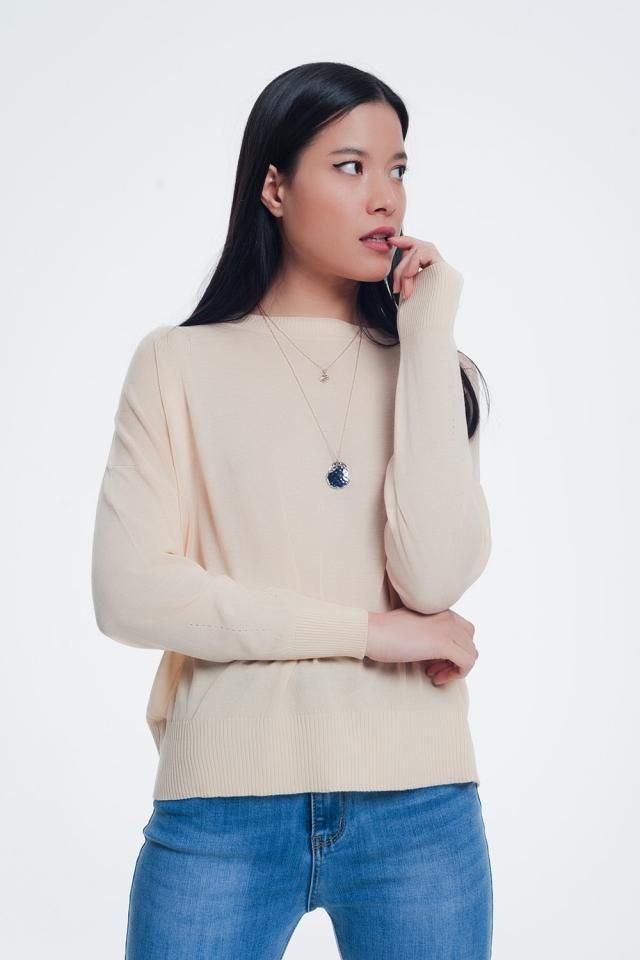 Klassieke beige trui met geribbelde boorden