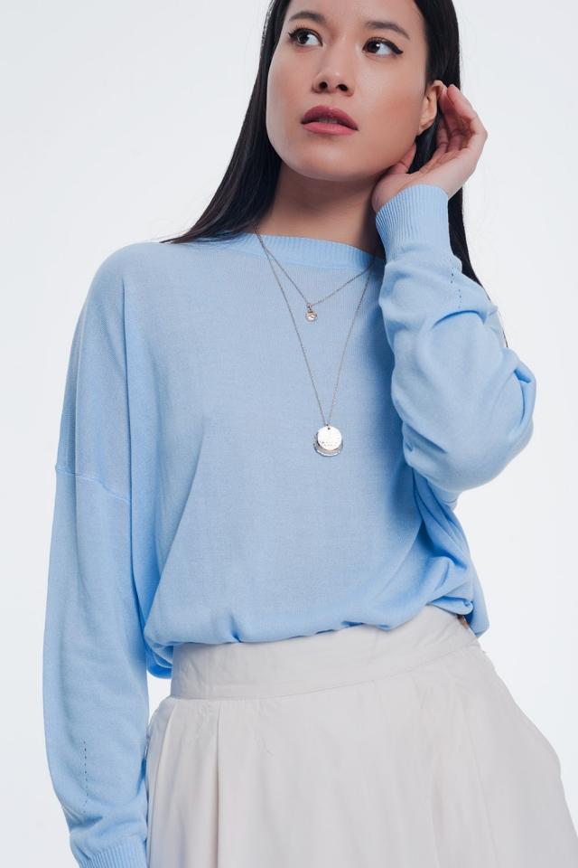 Klassieke blauwe trui met geribbelde boorden