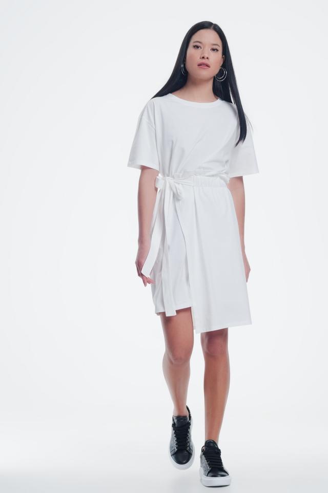Crème jurk met elastische zijband