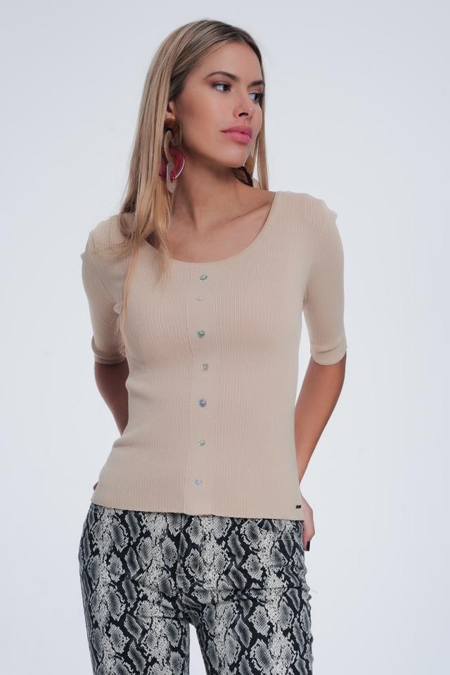 Aansluitende trui met knopen van geribbeld breisel in beige