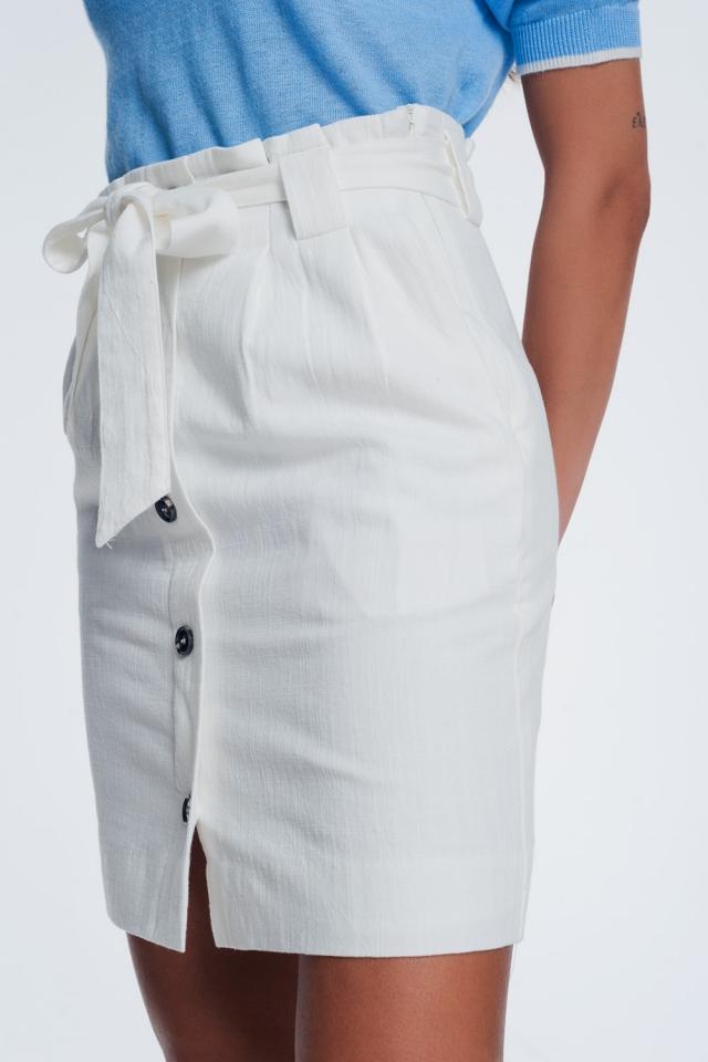 mini créme rok met knopen aan de voorkant